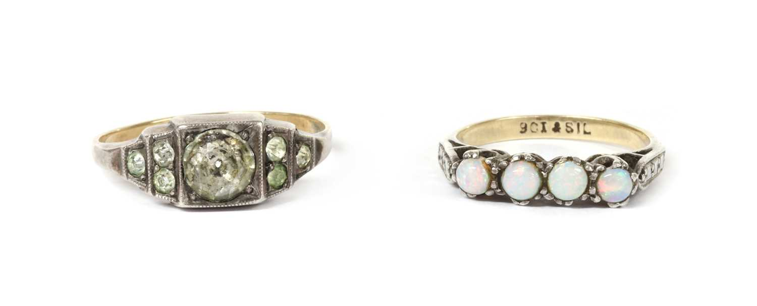 A silver and gold paste set ring,