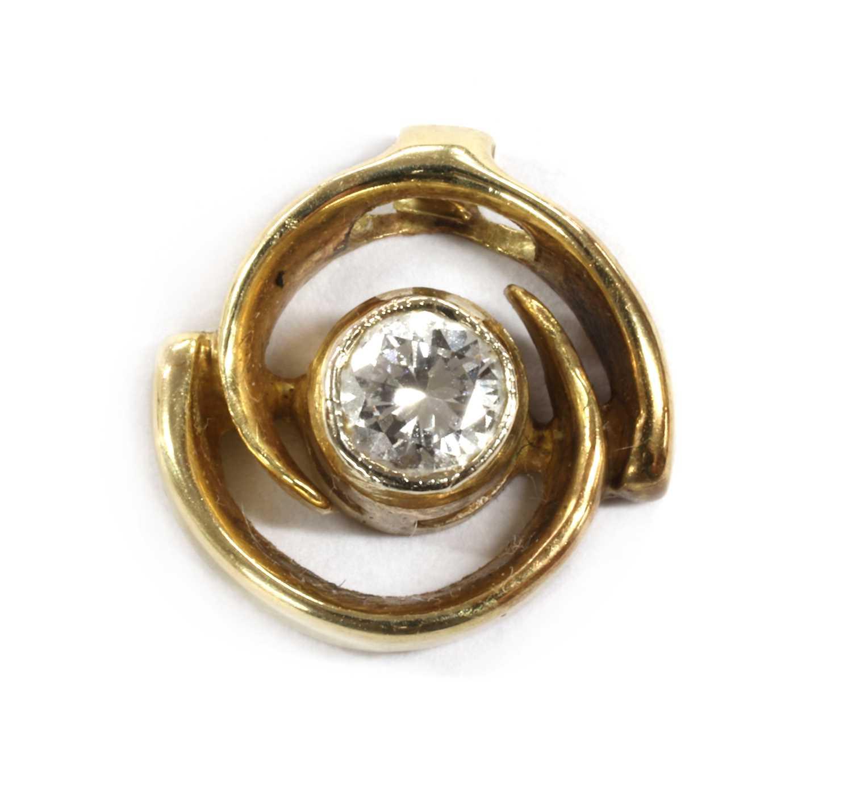 A gold single stone diamond pendant,
