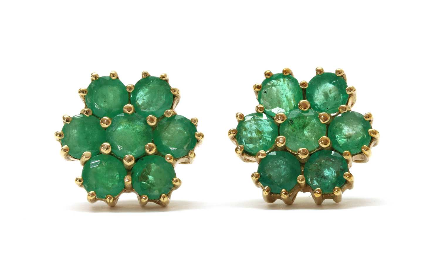 A pair of 9ct gold emerald daisy cluster earrings,