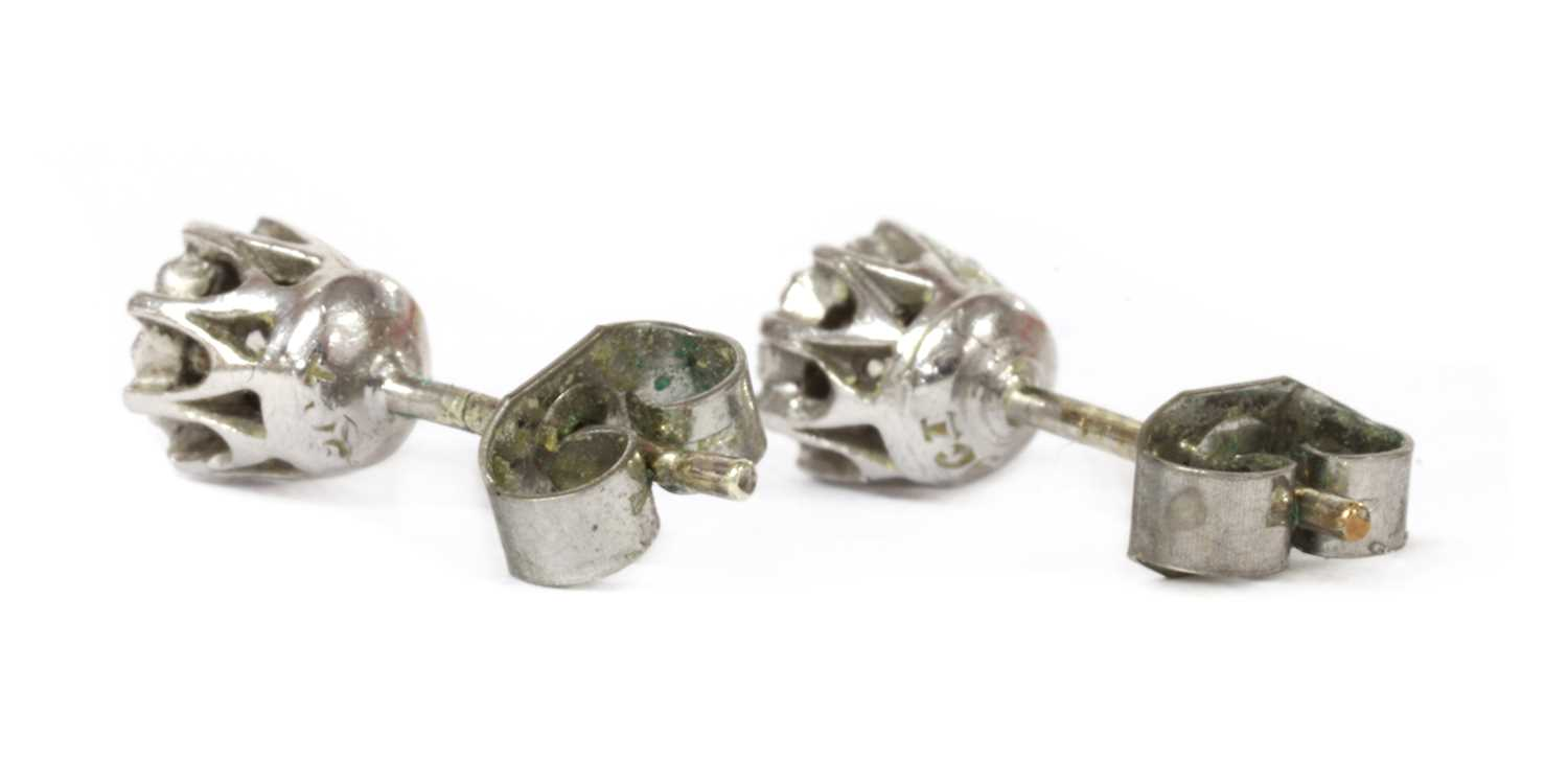 A pair of 9ct white gold single stone diamond stud earrings, - Image 2 of 2