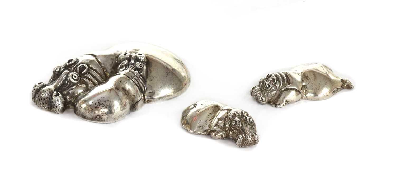 A silver sculpture of a hippopotamus and calf, by Patrick Mavros,