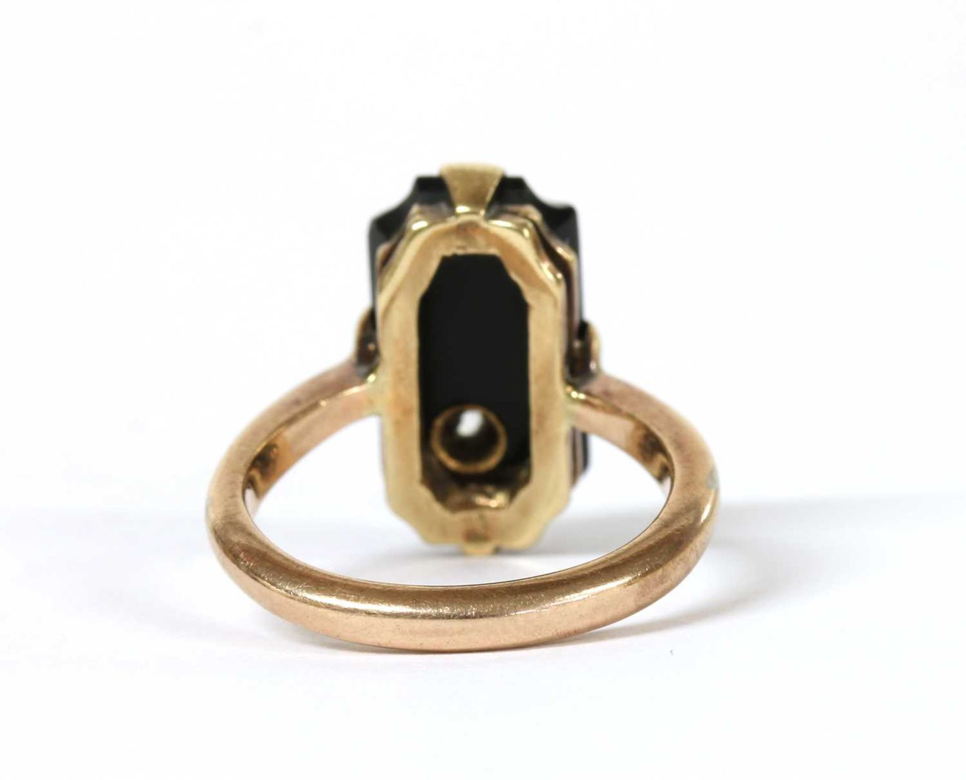 A gold diamond and onyx ring, - Image 3 of 3