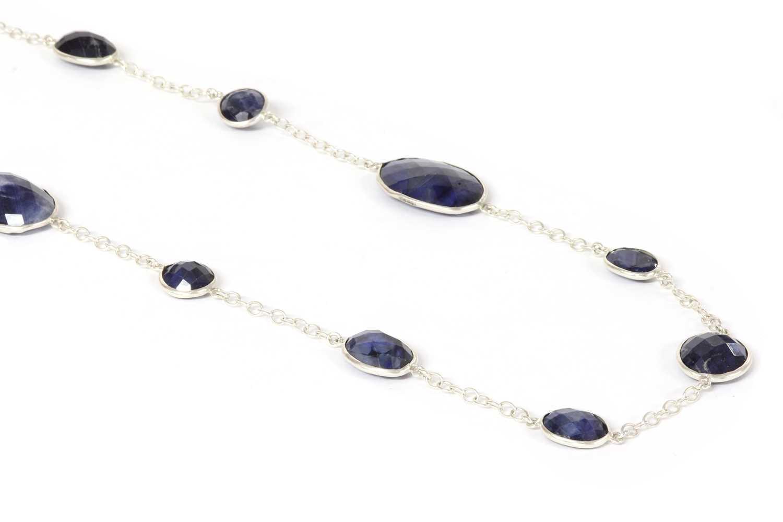 A silver sapphire long chain,