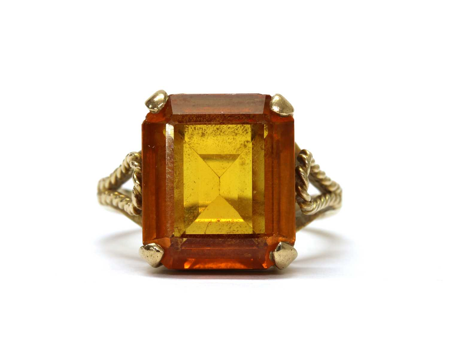A gold single stone synthetic orange sapphire ring,