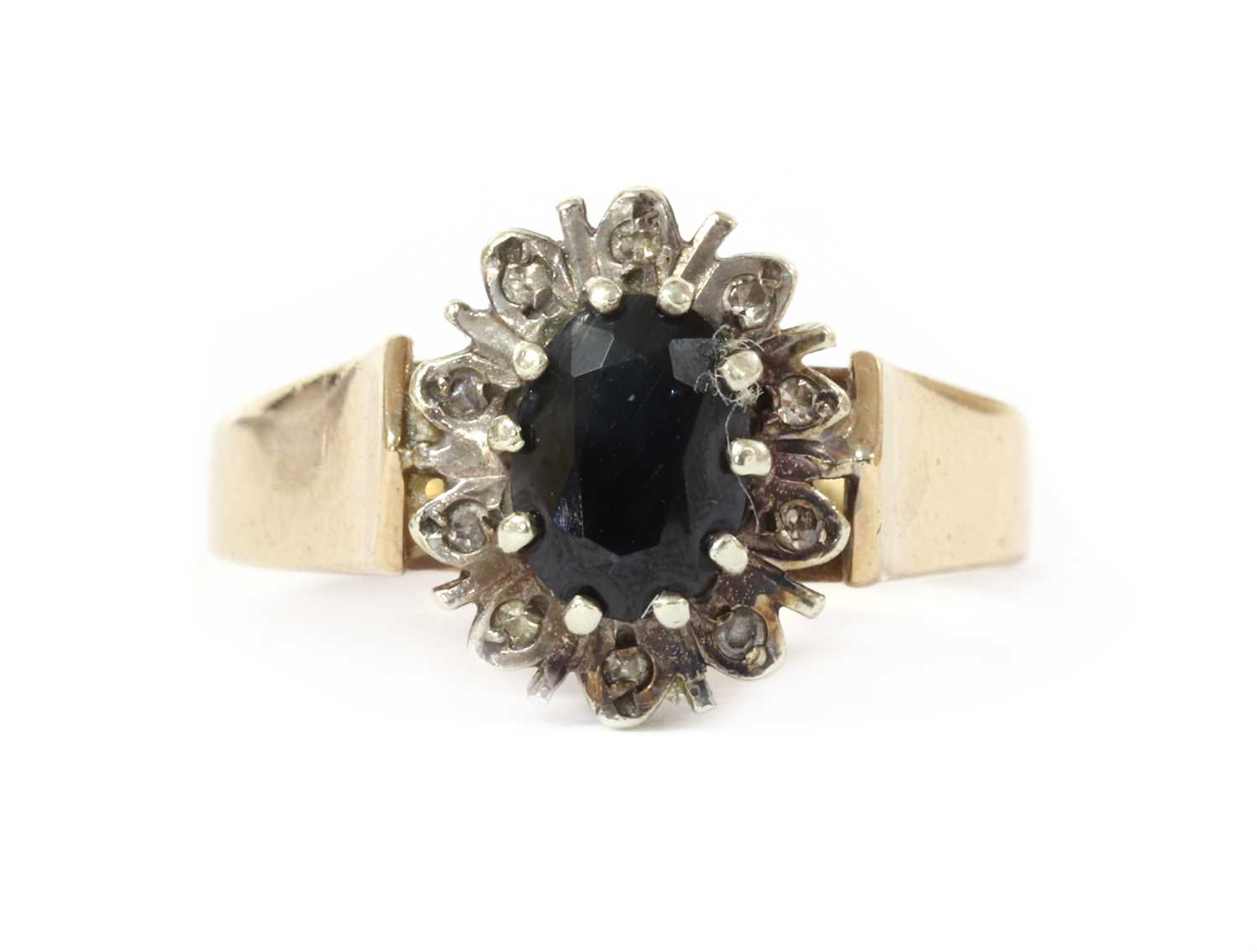A 9ct gold sapphire and diamond cluster ring,