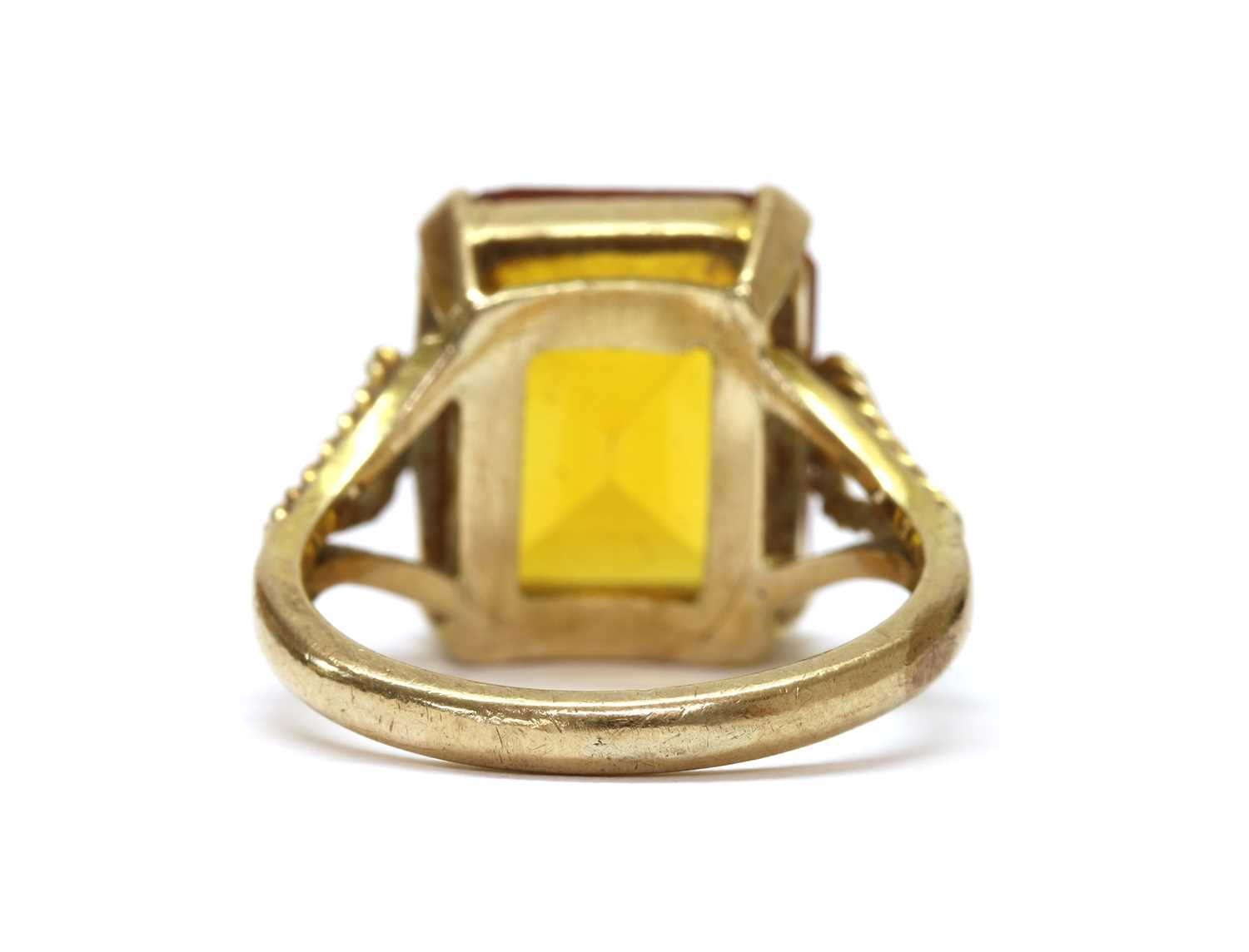 A gold single stone synthetic orange sapphire ring, - Image 3 of 3