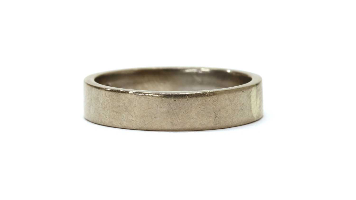 A white gold flat section wedding ring,