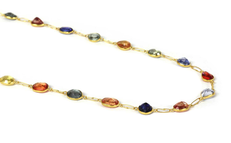A gold varicoloured sapphire rivière necklace,