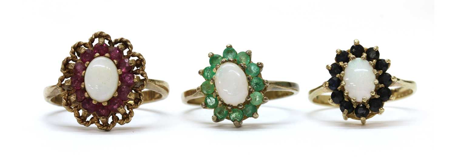 A 9ct gold opal and sapphire cluster ring,