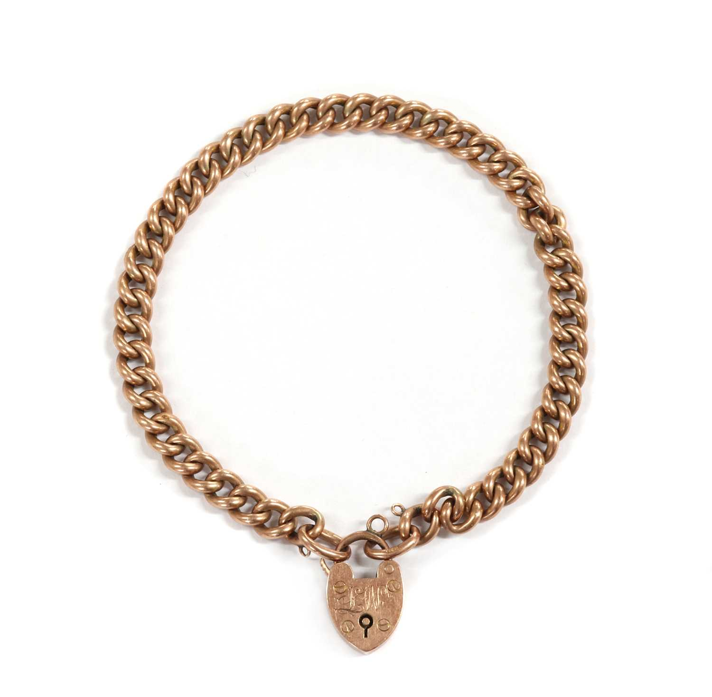 An Edwardian 9ct gold curb link bracelet, by Saunders & Shepherd,
