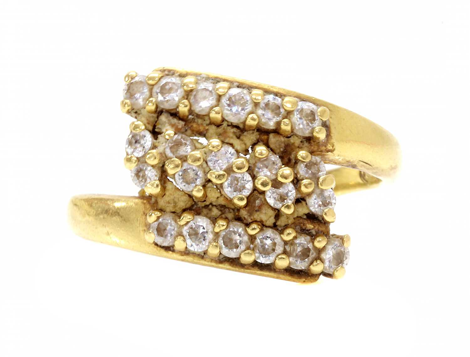 An Indian high carat gold cubic zirconia crossover ring,