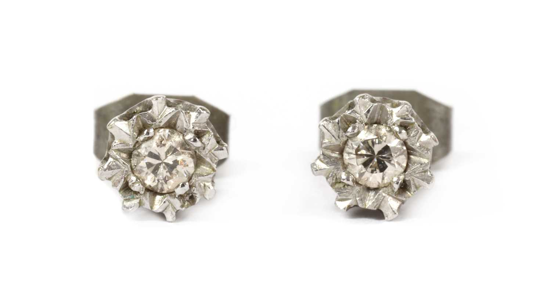 A pair of 9ct white gold single stone diamond stud earrings,