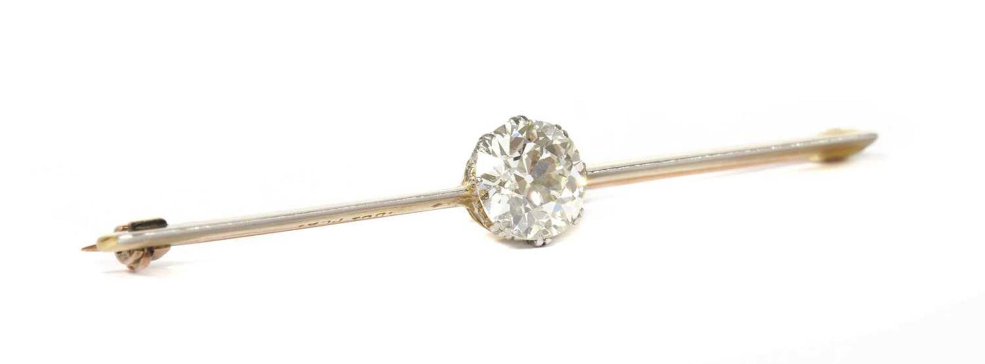 A gold and platinum single stone diamond bar brooch,