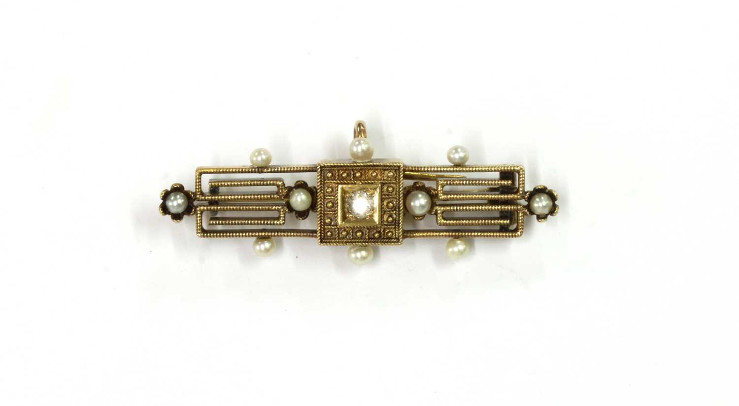 A gold Archaeological revival diamond and seed pearl brooch,