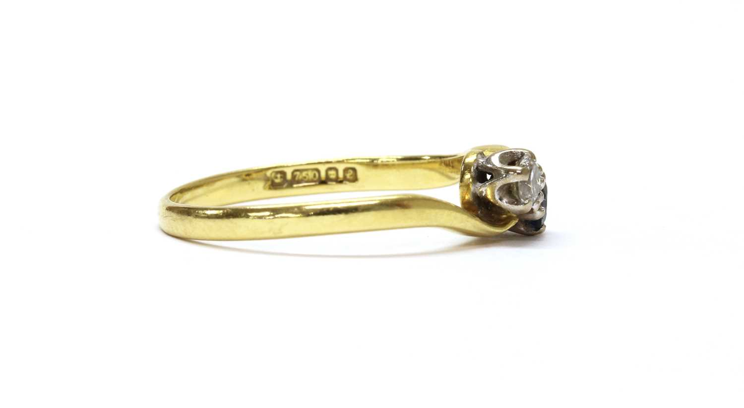 An 18ct gold two stone diamond and sapphire crossover ring, - Image 2 of 3