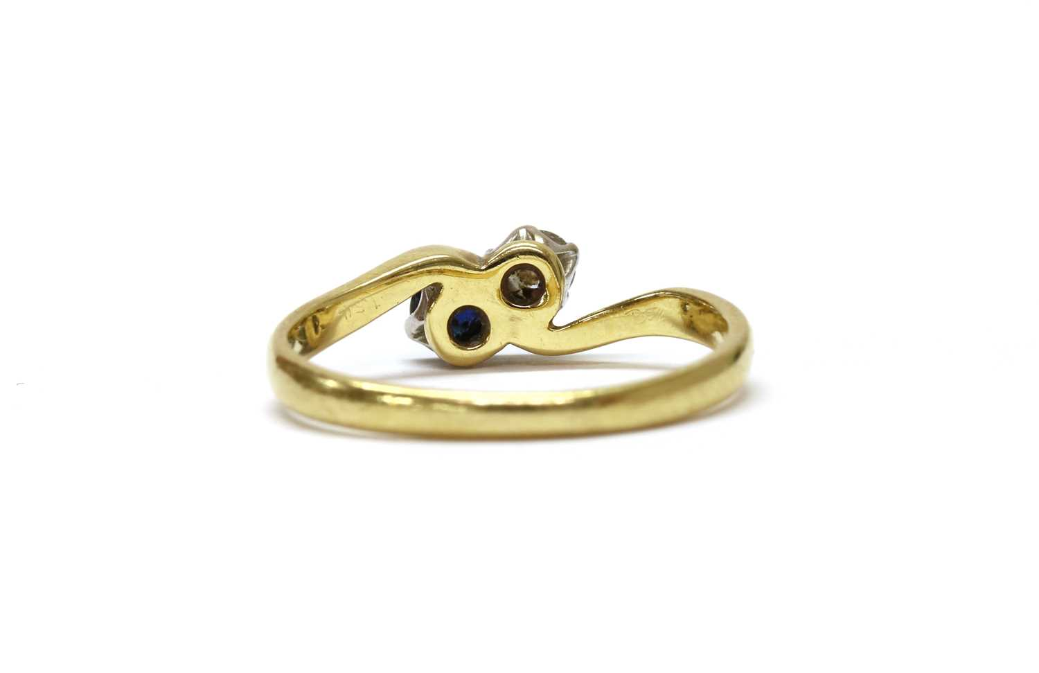 An 18ct gold two stone diamond and sapphire crossover ring, - Image 3 of 3