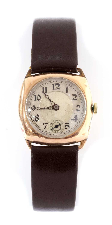 A 9ct gold cushion shaped mechanical strap watch,