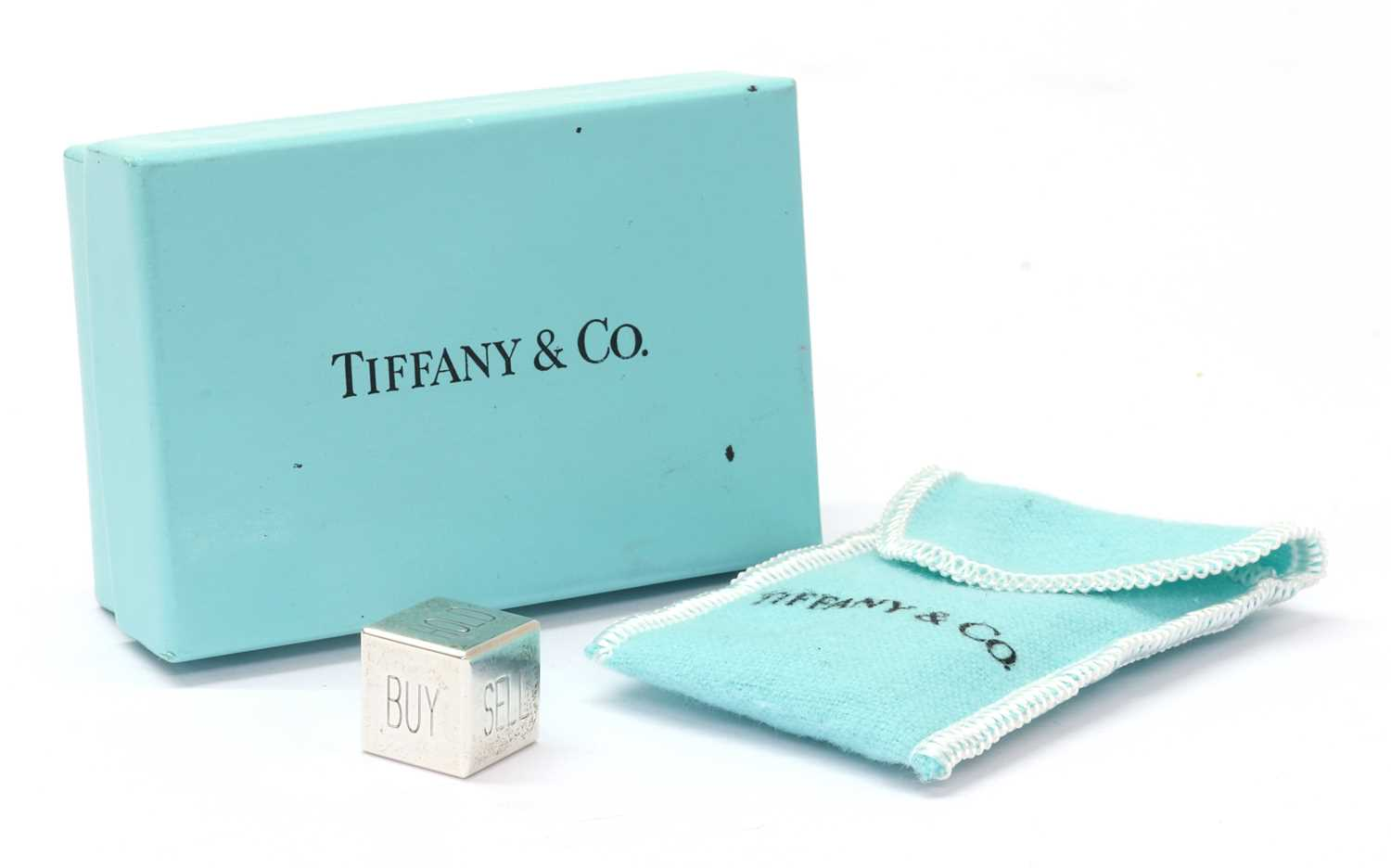 A sterling silver Tiffany & Co. 'Buy, Sell, Hold' decision maker die,