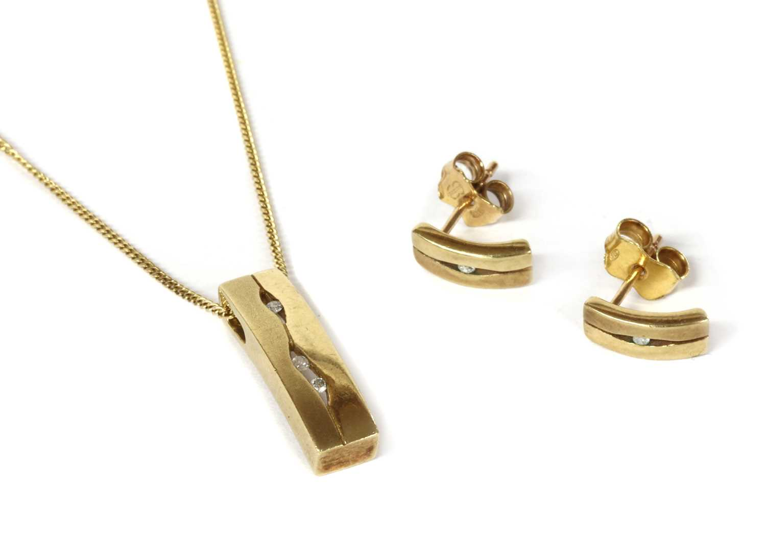 A 9ct gold diamond pendant and earrings suite,