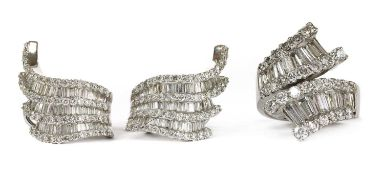 A white gold baguette cut diamond ring and earrings suite,