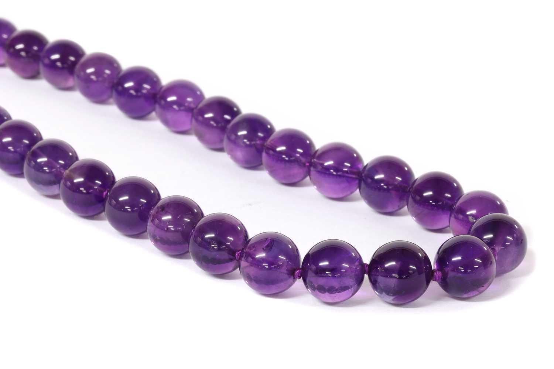 A single row uniform amethyst bead necklace,