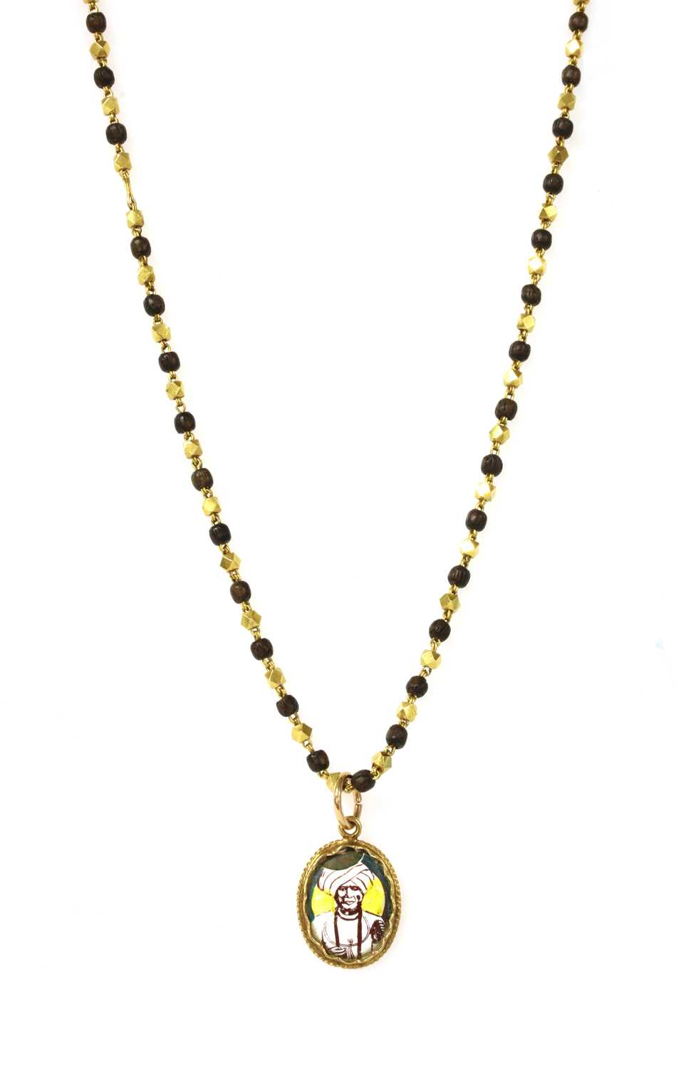 An Indian high carat gold pendant and chain,