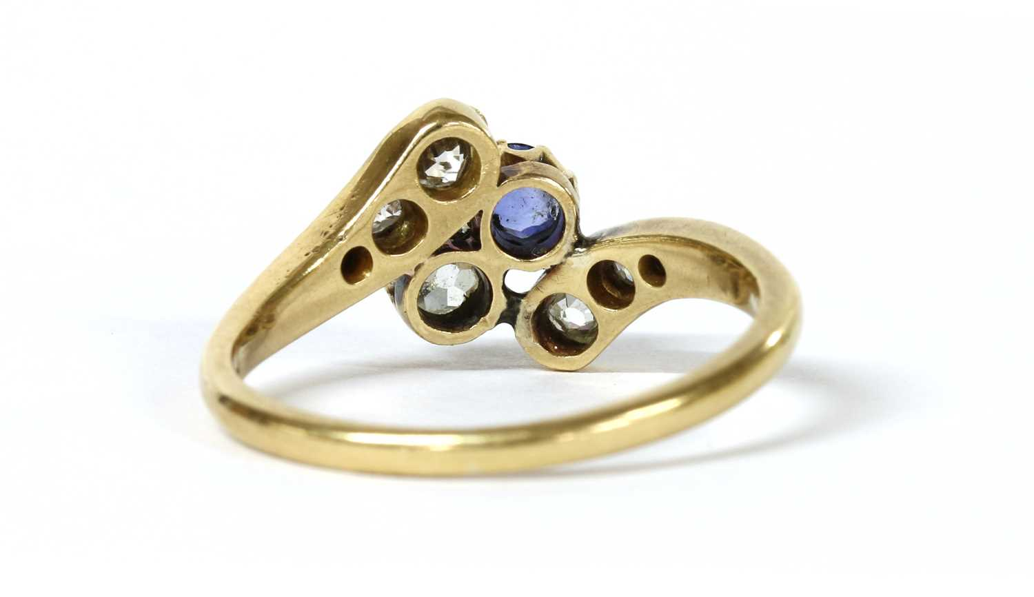 An Edwardian gold sapphire and diamond crossover ring, - Image 3 of 3