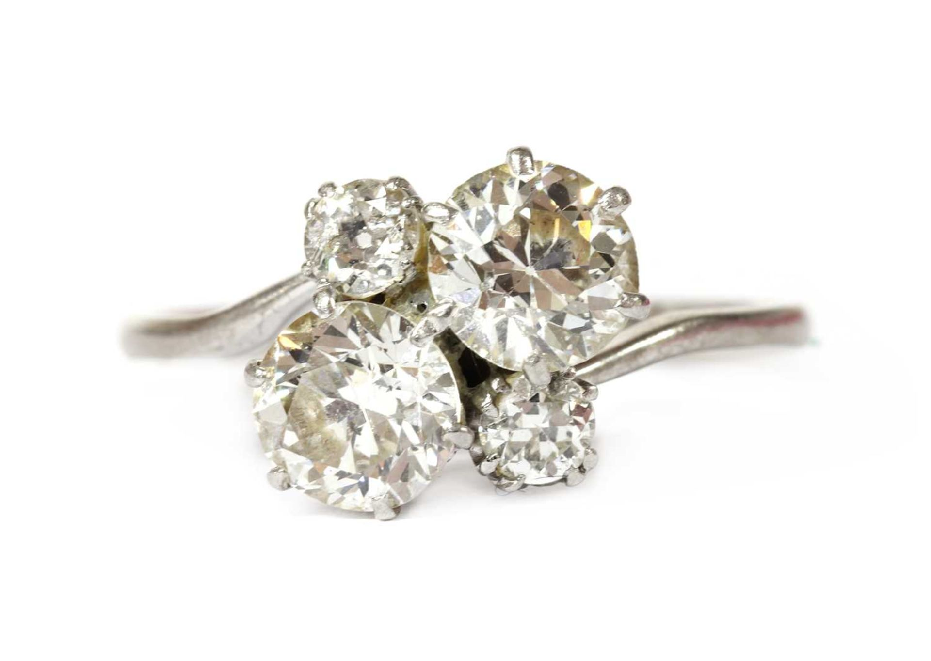 A white gold four stone diamond cluster ring,