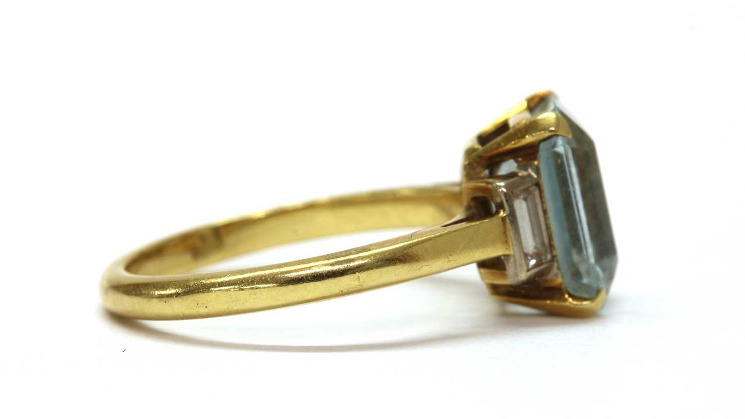A gold blue topaz and diamond three stone ring, - Image 2 of 3