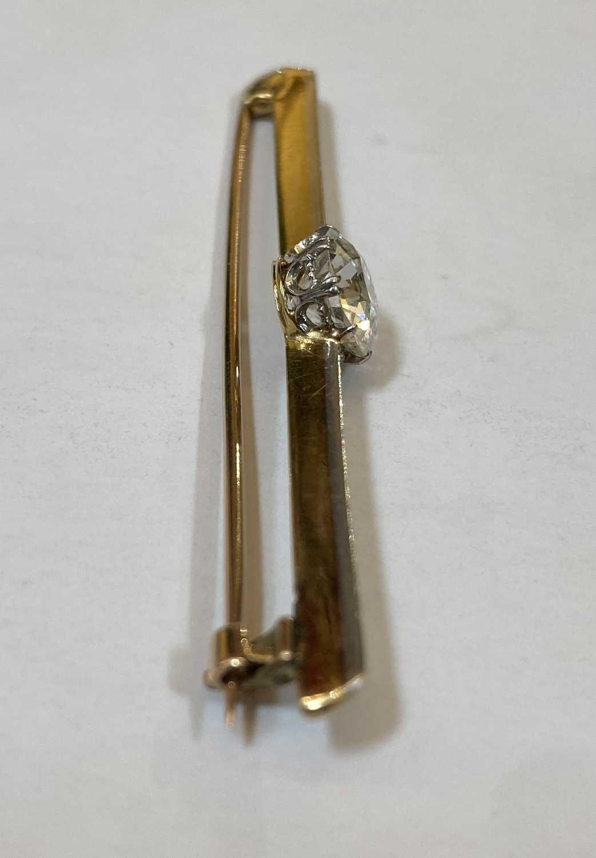 A gold and platinum single stone diamond bar brooch, - Image 4 of 5