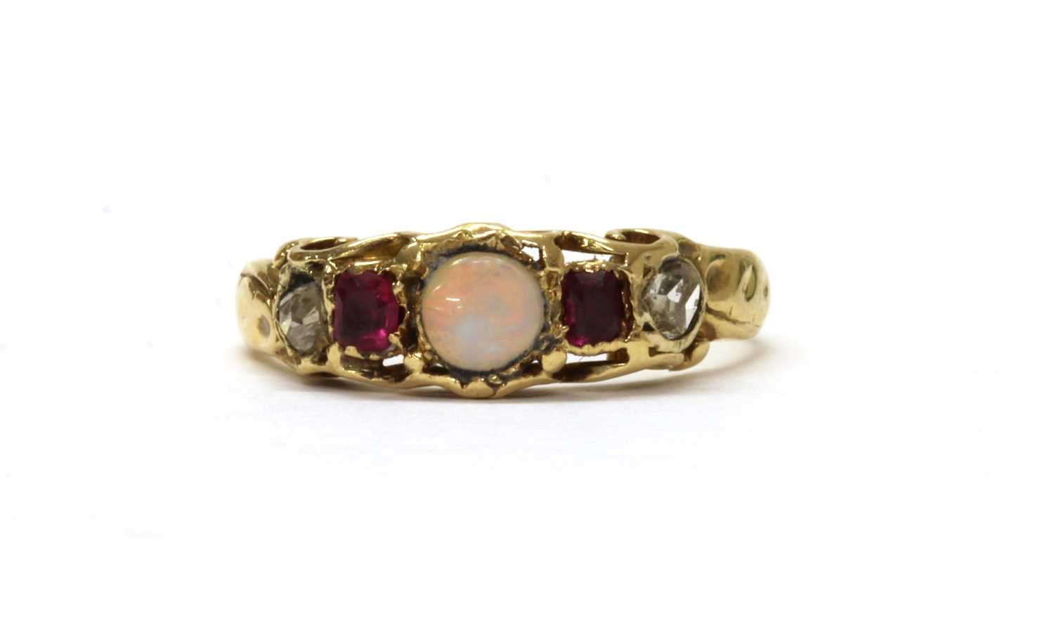 A gold opal, ruby and diamond ring,