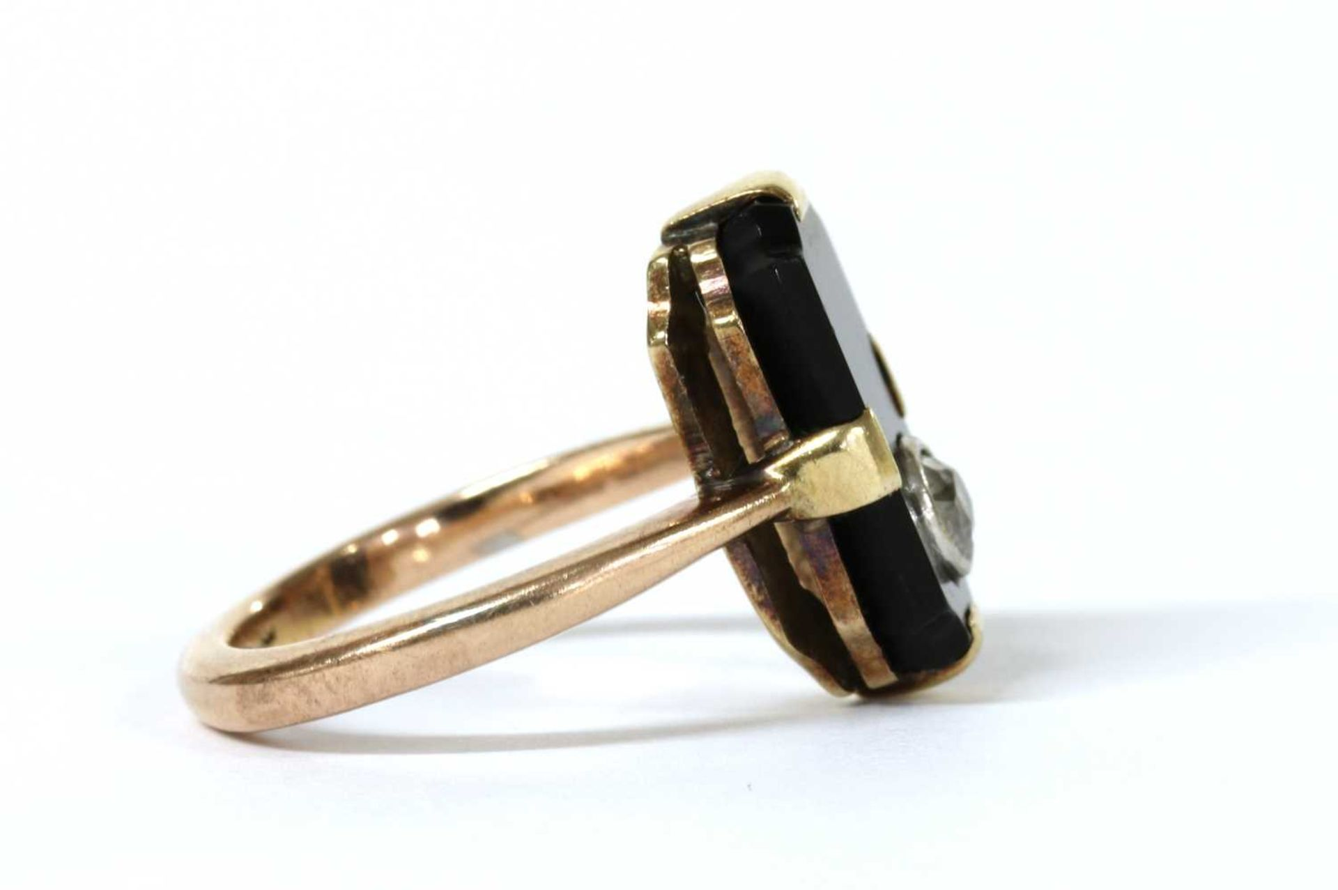 A gold diamond and onyx ring, - Image 2 of 3