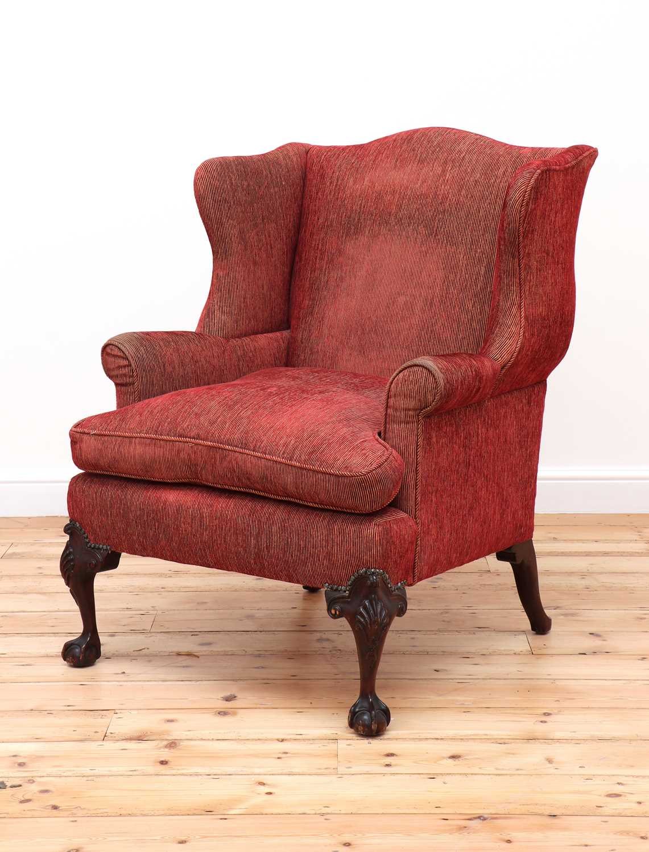 A George III-style mahogany-framed wingback armchair,