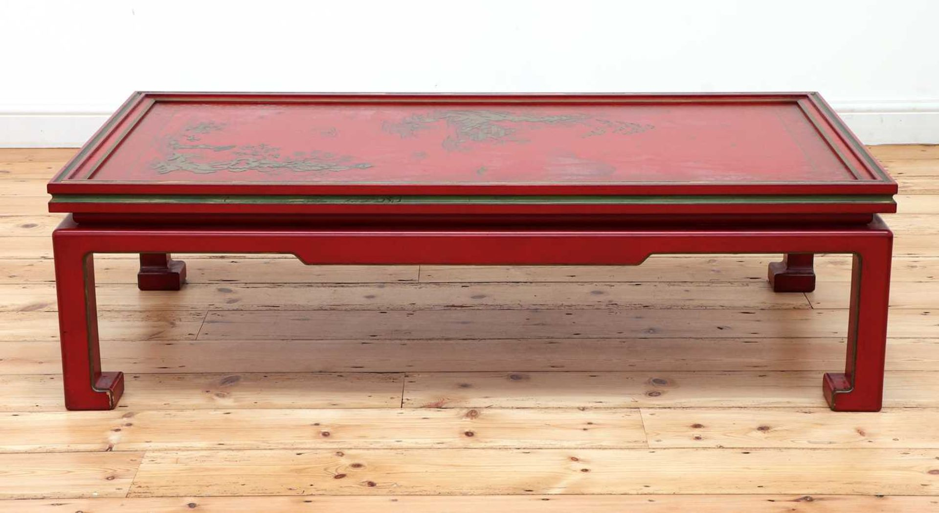 A Chinese-style red-lacquered coffee table in the manner of Mallett & Sons,