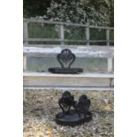 A pair of Regency cast iron boot scrapes,