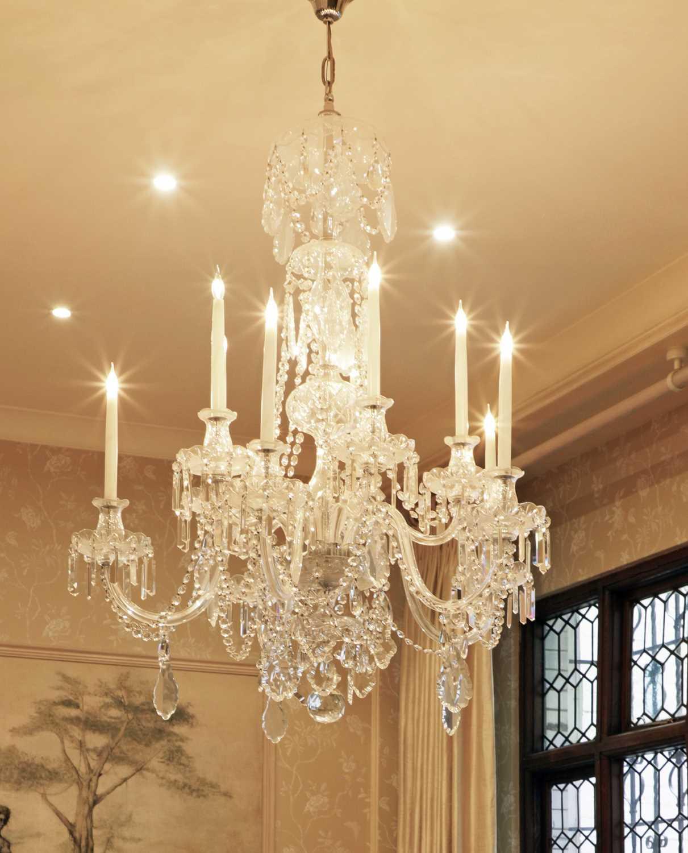 A George III-style cut-glass ten-light chandelier,