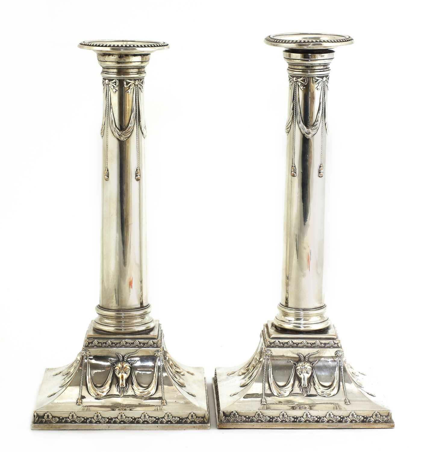 A pair of Edwardian silver-plated neoclassical candlesticks,
