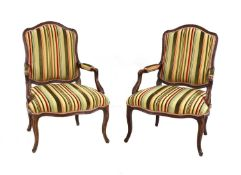 A pair of French Louis XV beech fauteuils,