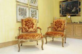 A pair of French Louis XV giltwood fauteuils à la reine,