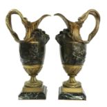 A pair of large gilt-bronze and bronze ewers,