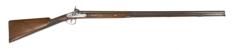 A single-barrelled percussion shotgun,