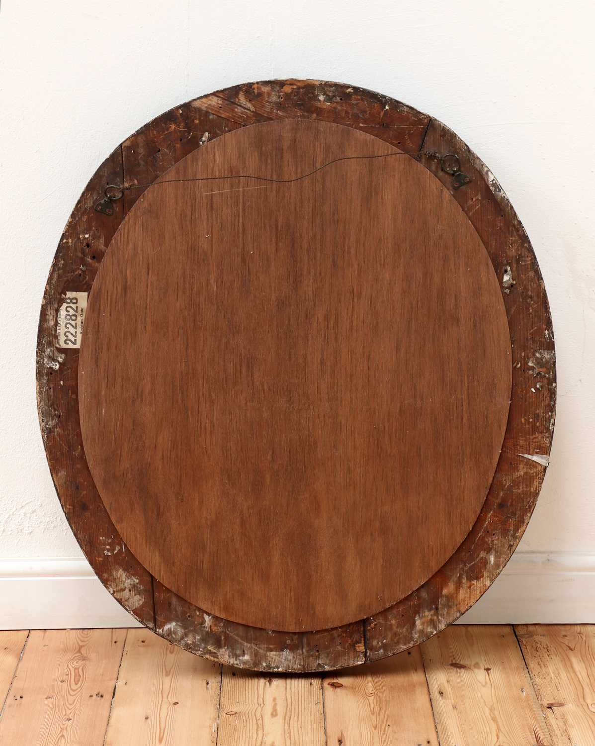 A carved giltwood and ebonised oval wall mirror, - Image 3 of 3