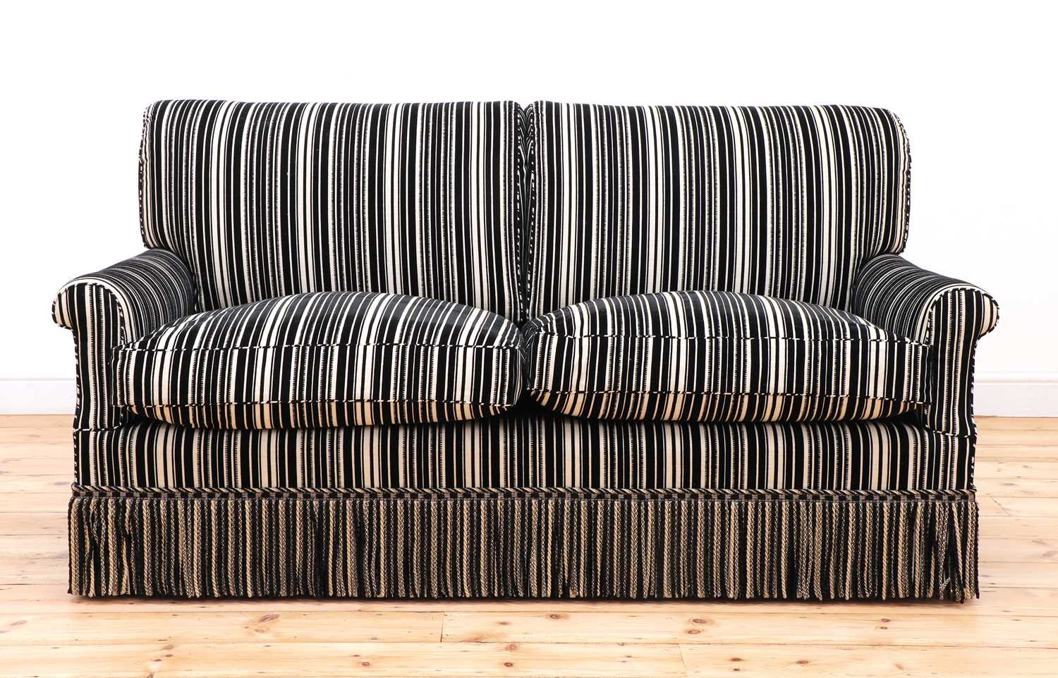 A modern two-seater sofa by Howard Chairs Ltd.