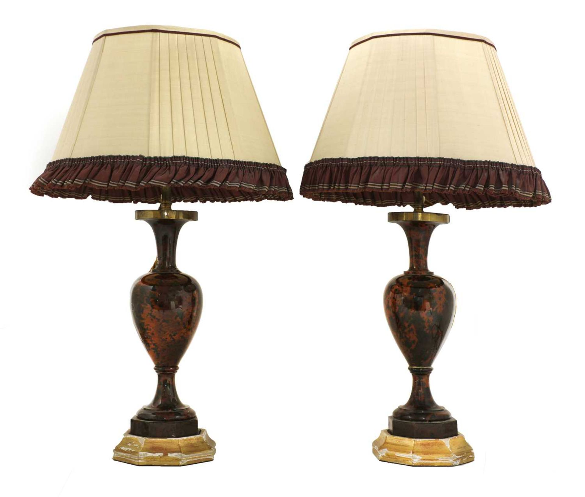 A pair of polished hardstone table lamps,