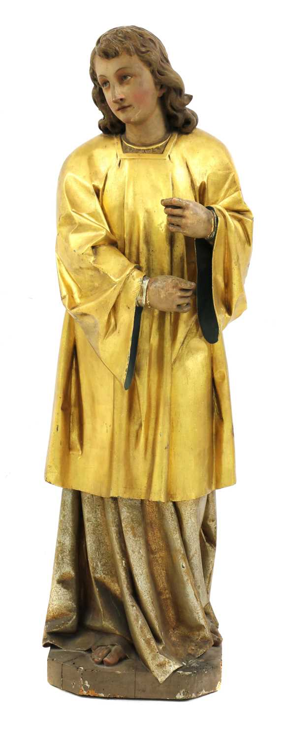 A Continental carved wood figure of a saint,