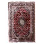 A Persian wool and silk Kashan carpet,