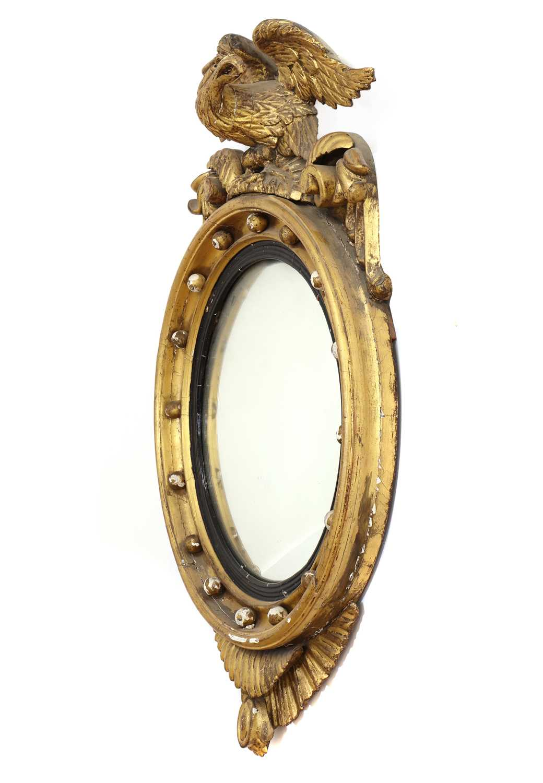 A Regency period circular gilt eagle wall mirror, - Image 4 of 4