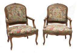A pair of French Louis XV-style beech fauteuils,