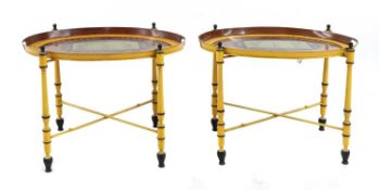 A pair of Regency-style yellow-painted toleware side tables,