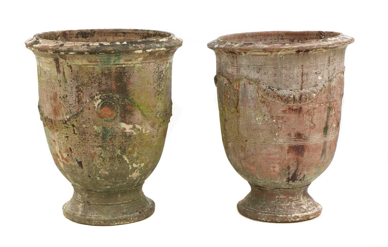 Two similar 'Poterie d'Anduze' glazed terracotta garden urns,